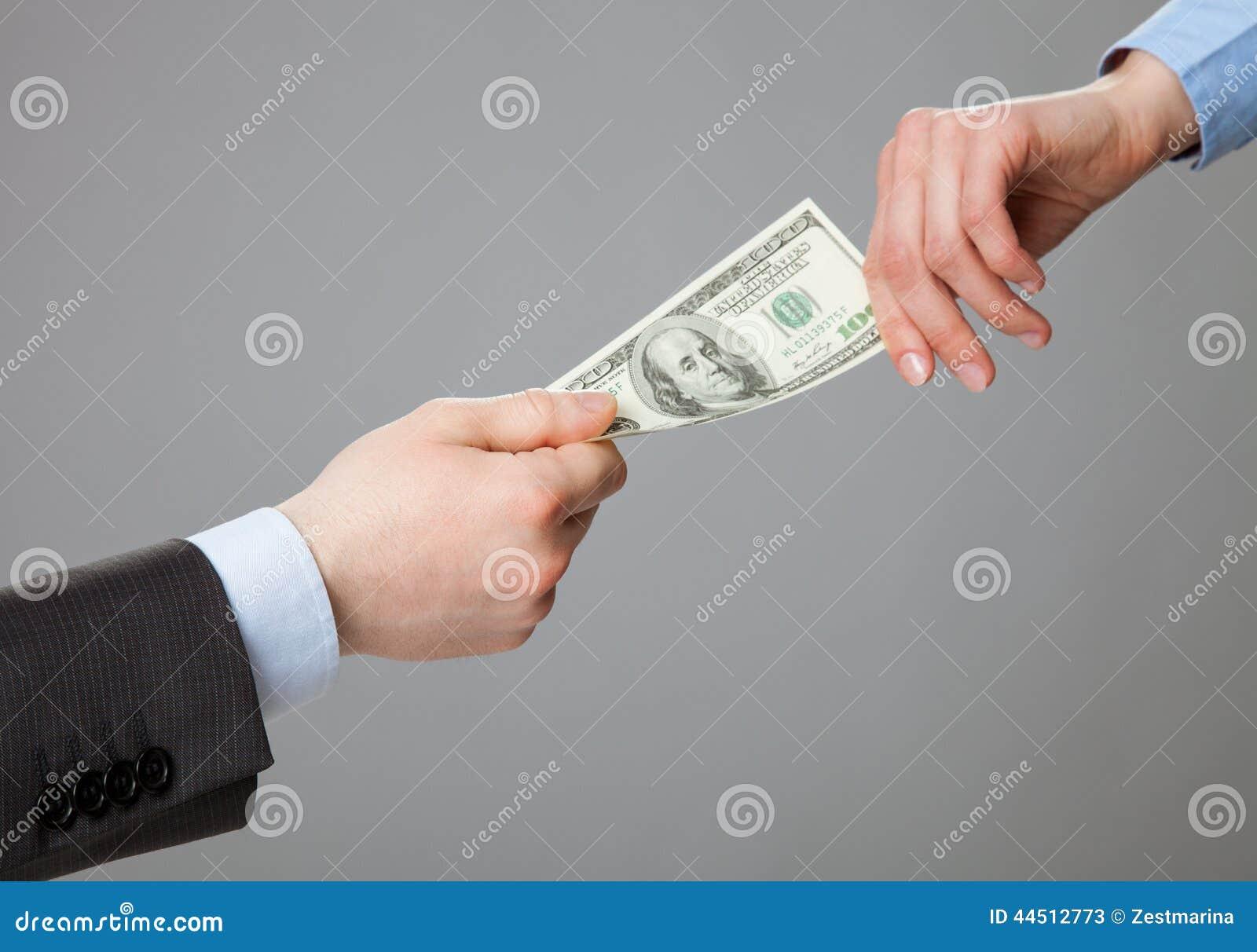 Business people hands exchanging money