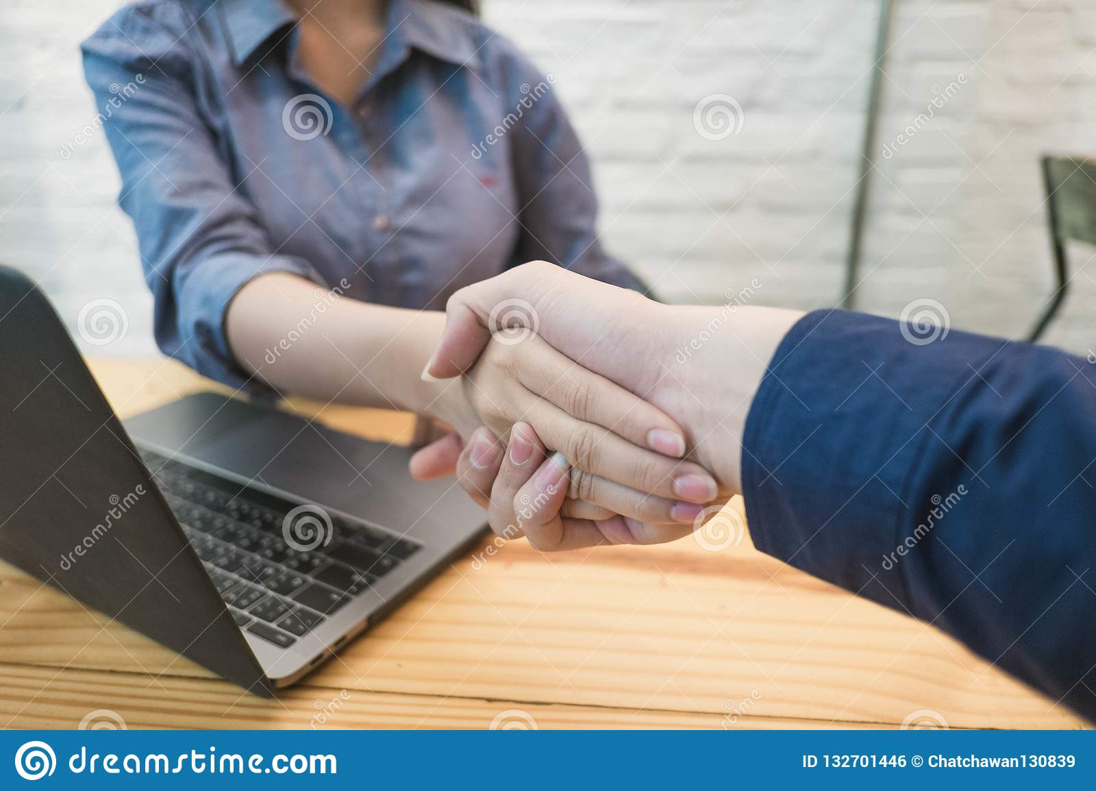 Business people handshakeing in the office. Business partner Con