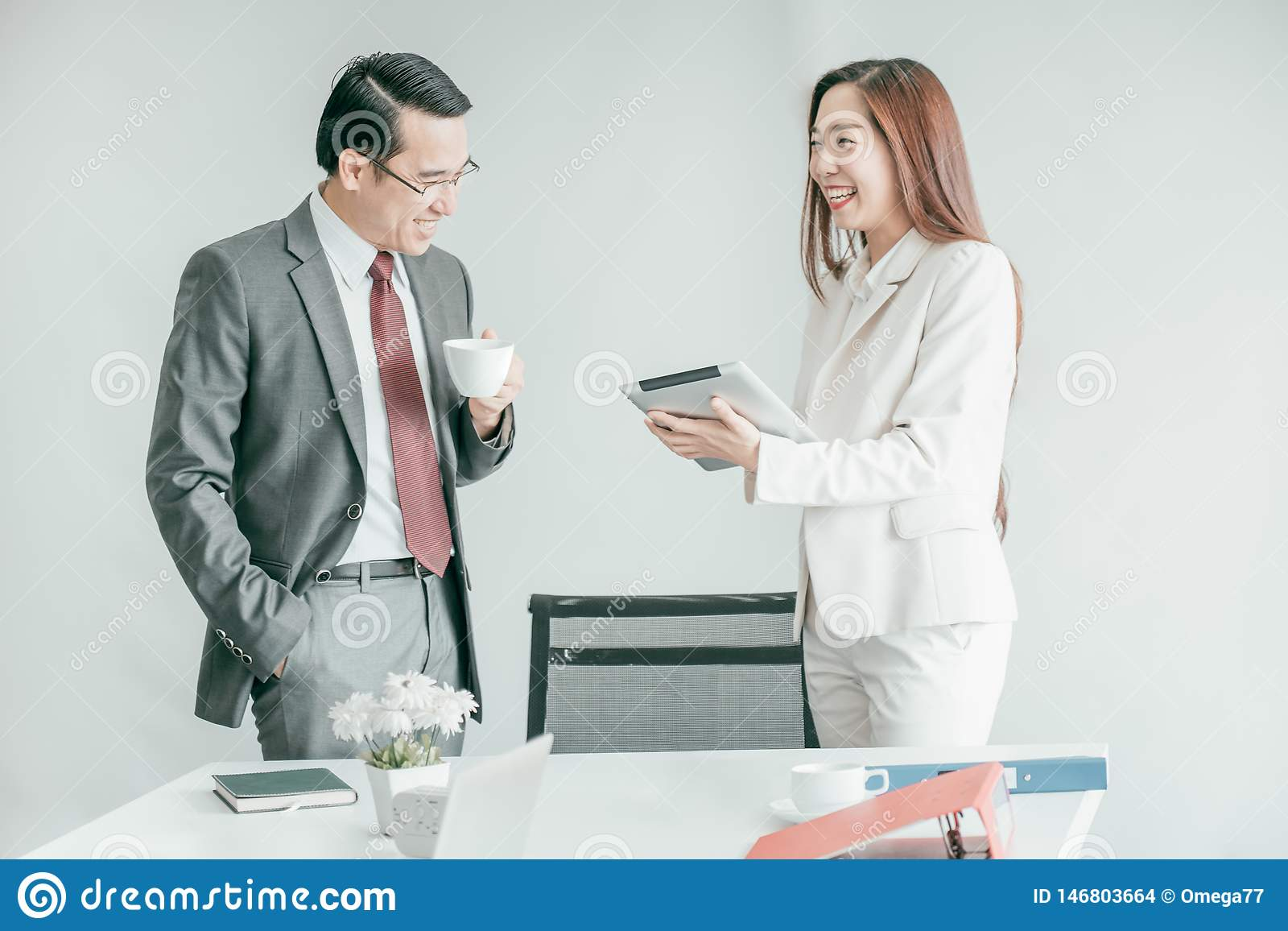 Business people having fun and talking at workplace office