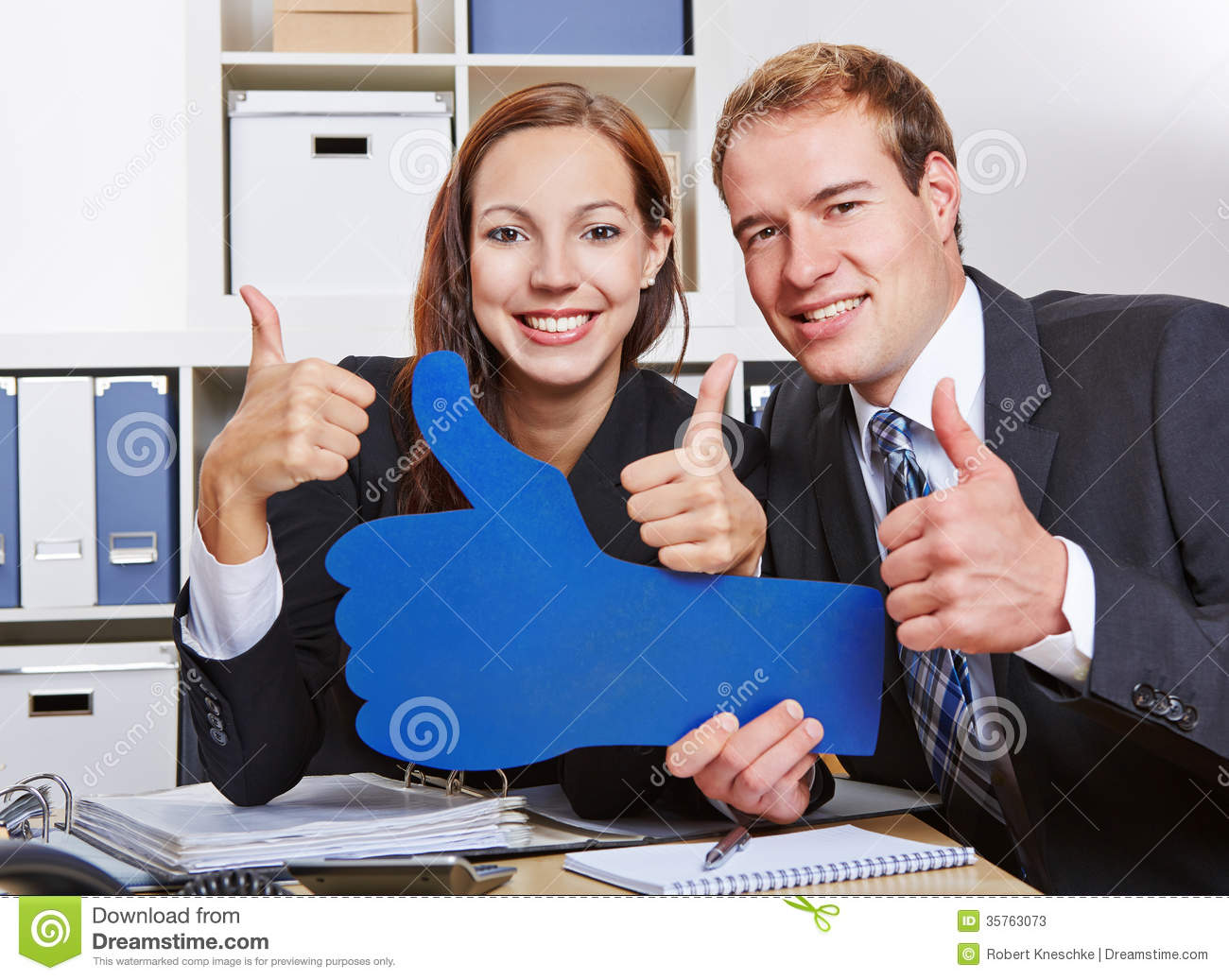 Business people holding many thumbs