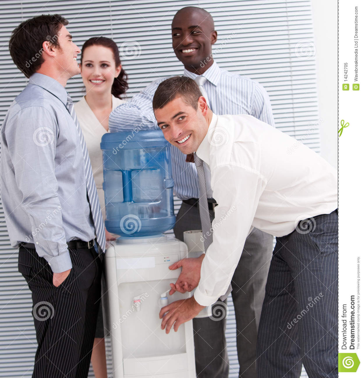 Business People Interacting At A Water Cooler Stock Image - Image ...