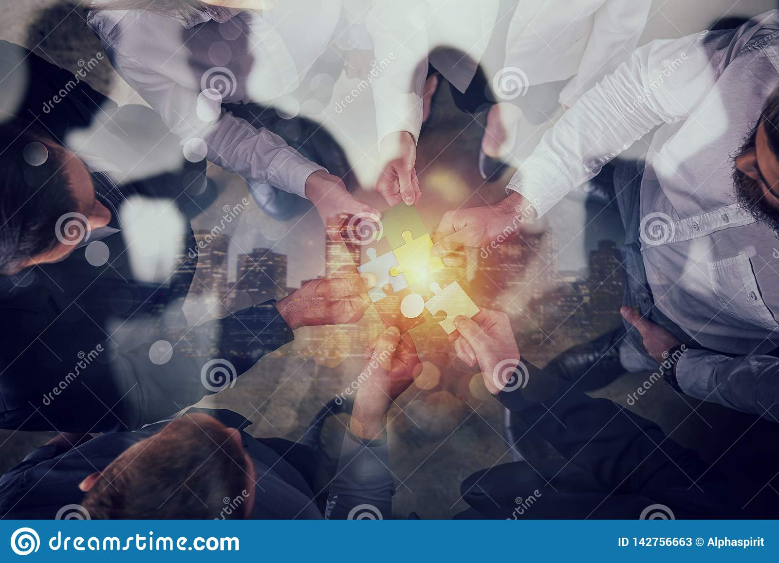Business people join puzzle pieces. Concept of teamwork and partnership. double exposure.