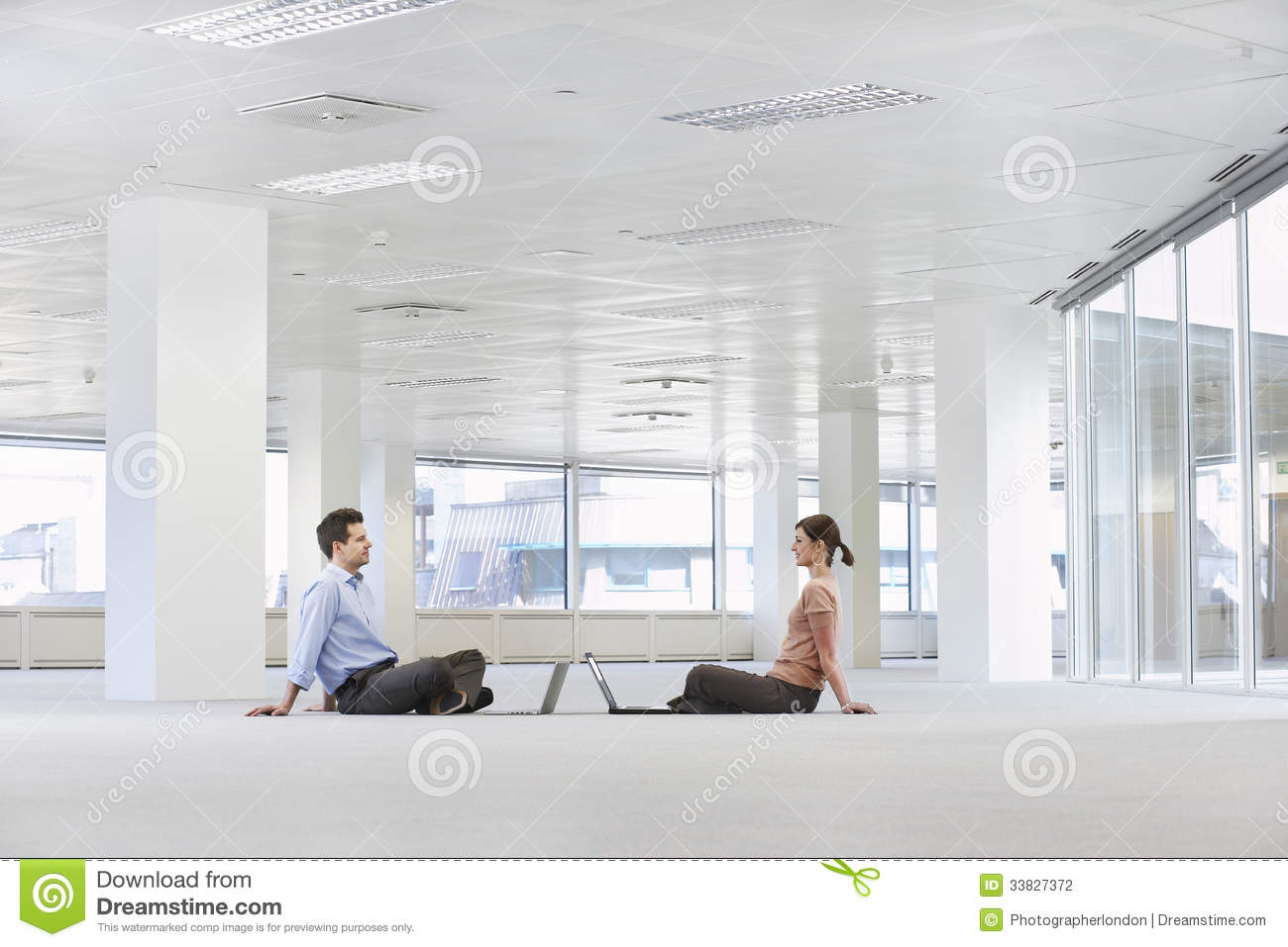 Business People With Laptops In Empty Office Space Stock