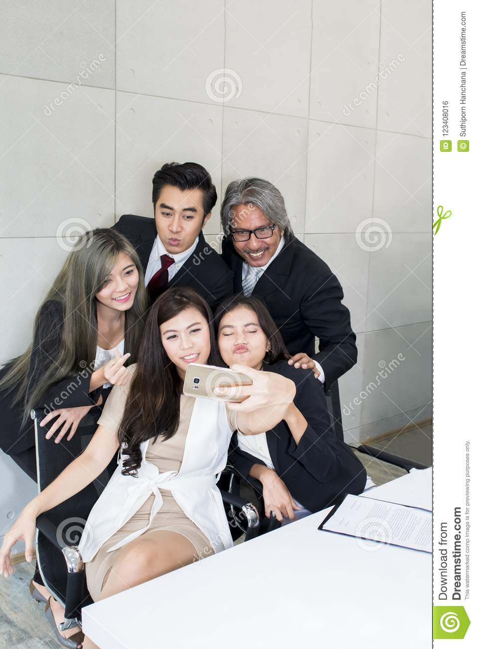 Business people make selfie photo and smiling.