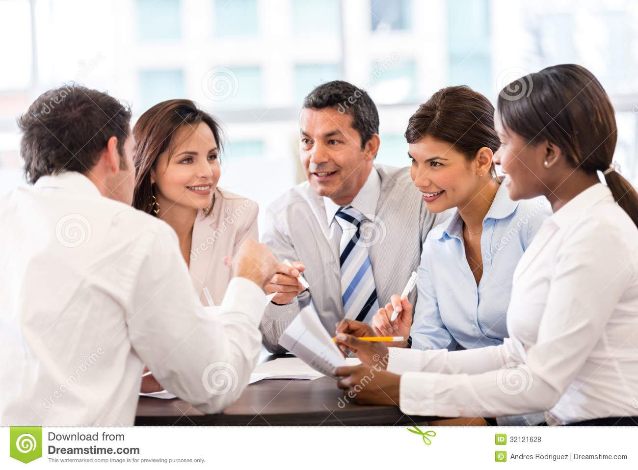 Business Woman In A Meeting At The Office Smiling Stock Photo ...