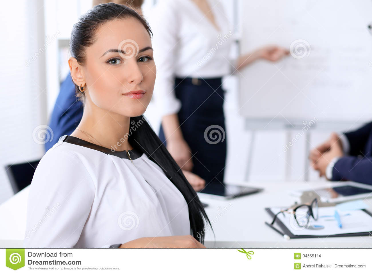 Business people at a meeting in the office. Focus on boss woman