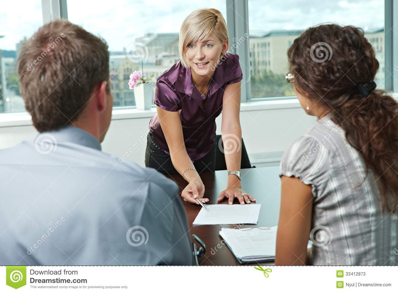 Team Of Casual Looking Business People Having Business Meeting At