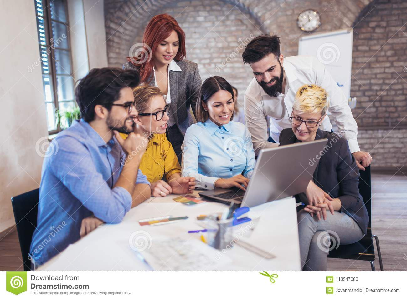 Business People Meeting To Discuss Ideas In Modern Office Stock