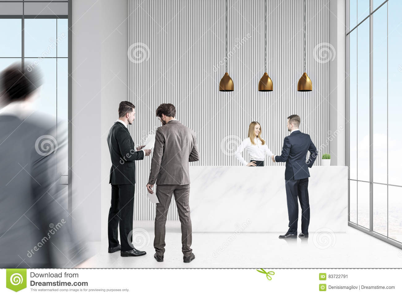 Business People Near Reception Desk In Office Stock Photo