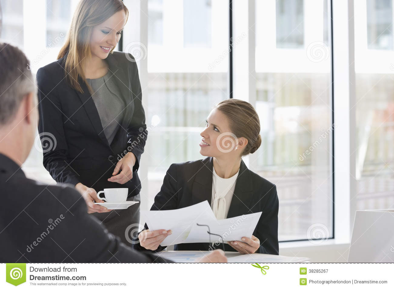 Business People With Paperwork During Coffee Break Stock ...