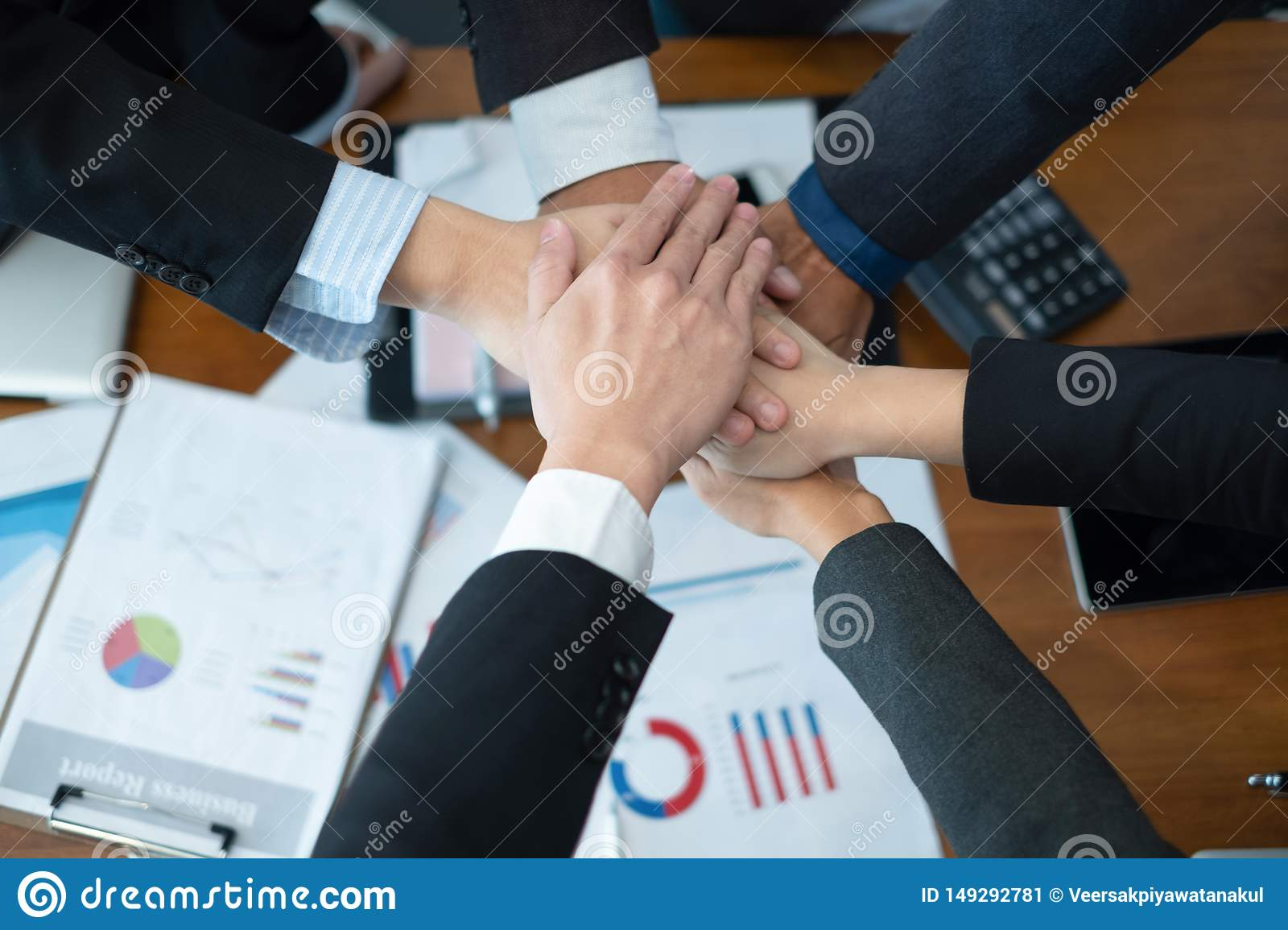 Business people put their hands together.businesspeople celebrating in office success deal business, business concept, business