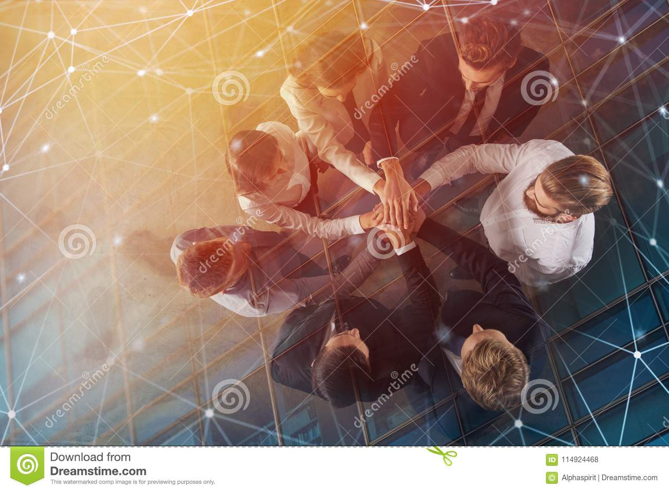 Business people putting their hands together with internet network effects. Concept of integration, teamwork and