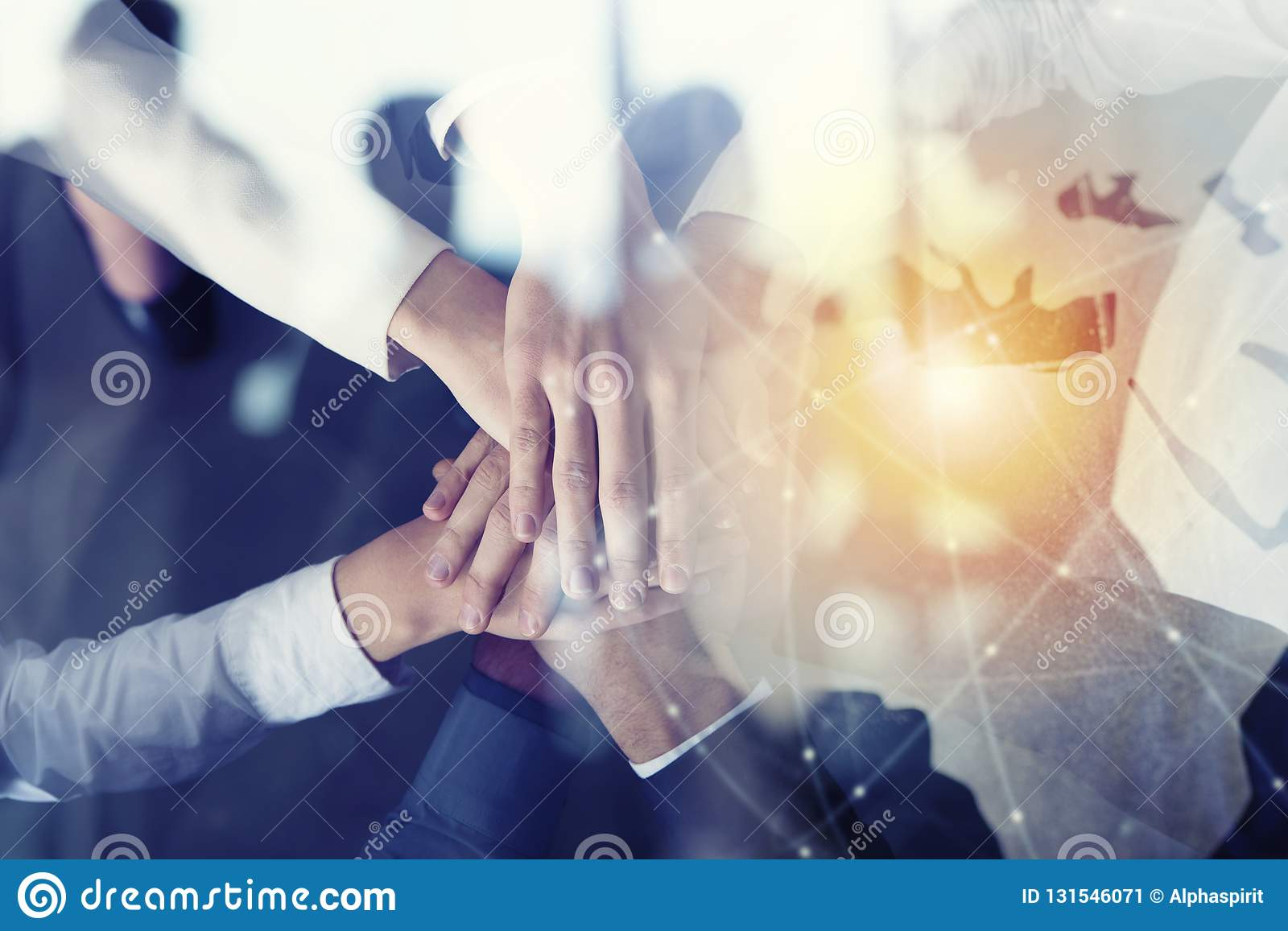 Business people putting their hands together. Concept of startup, integration, teamwork and partnership. Double exposure