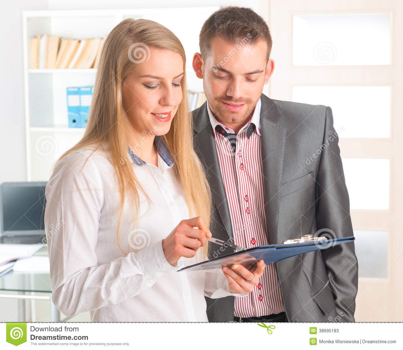 Business people reading a document together