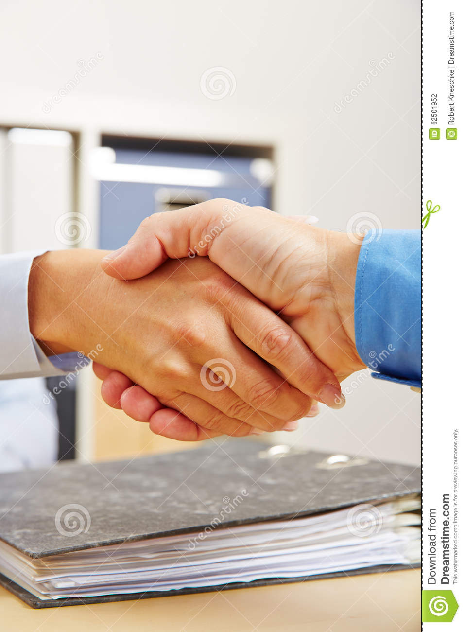 Business people shake hands in office