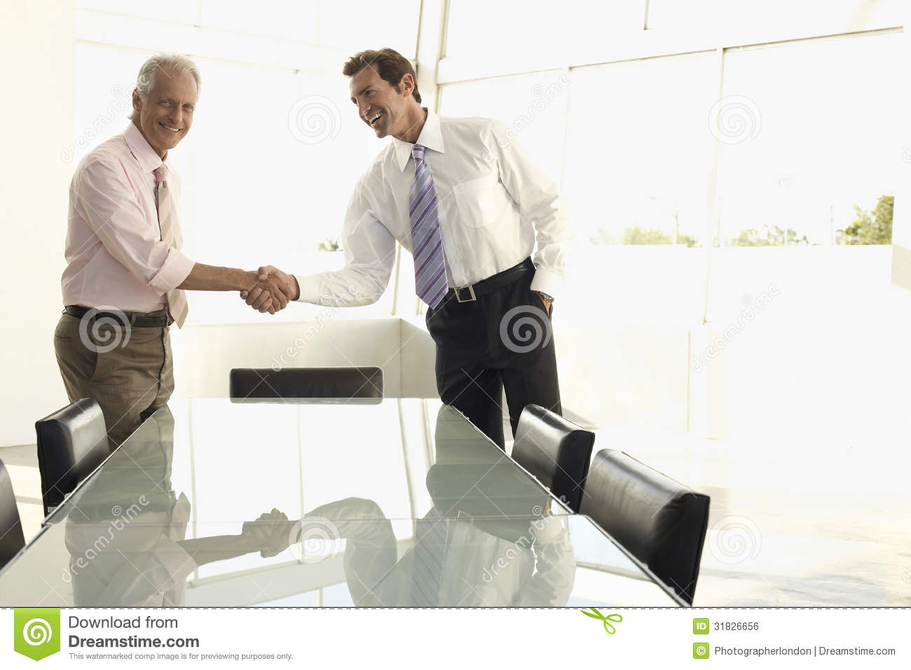 Business People Shaking Hands In Conference Room Royalty