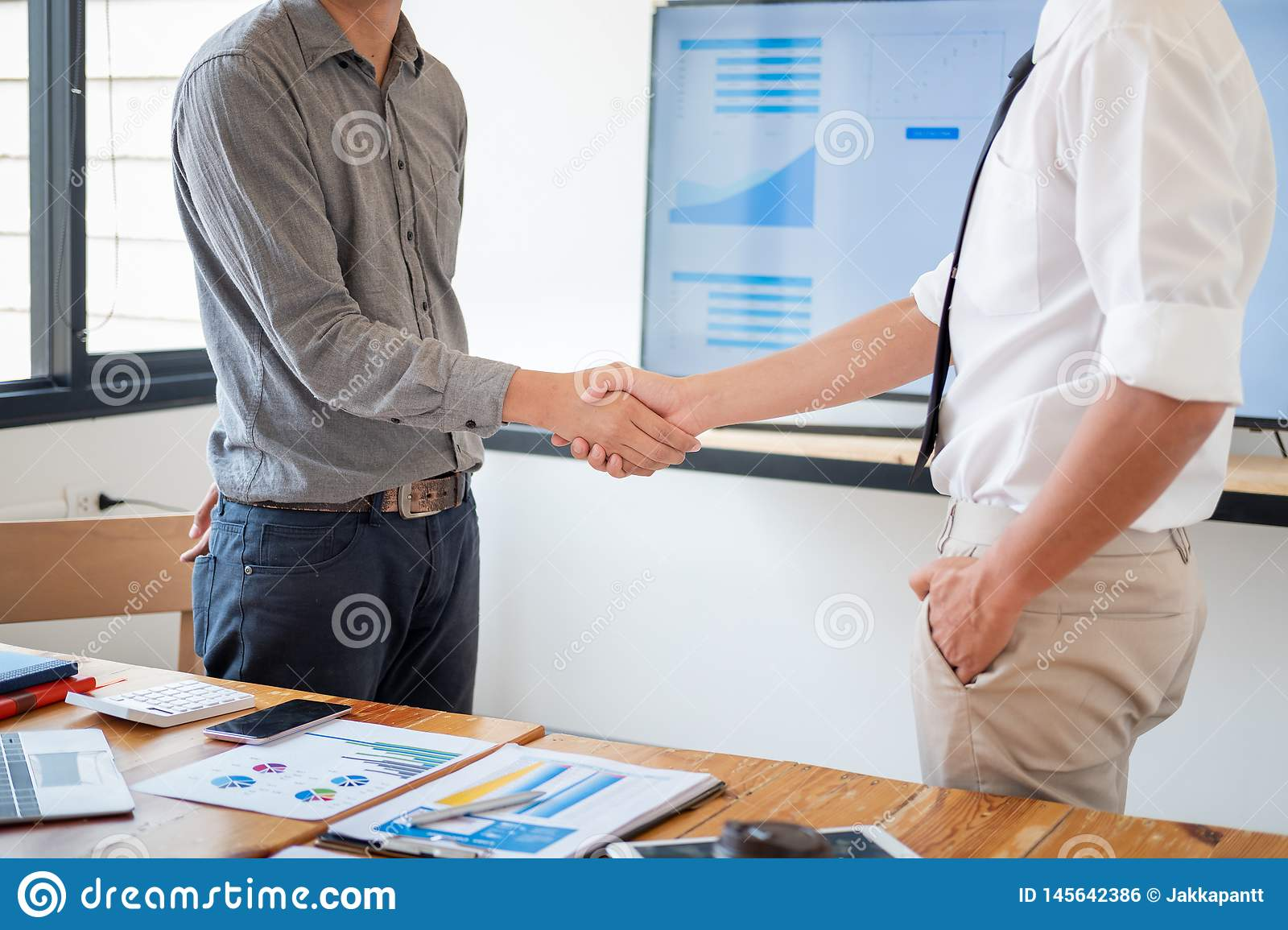 Business people shaking hands in meeting room, Successful deal after meeting