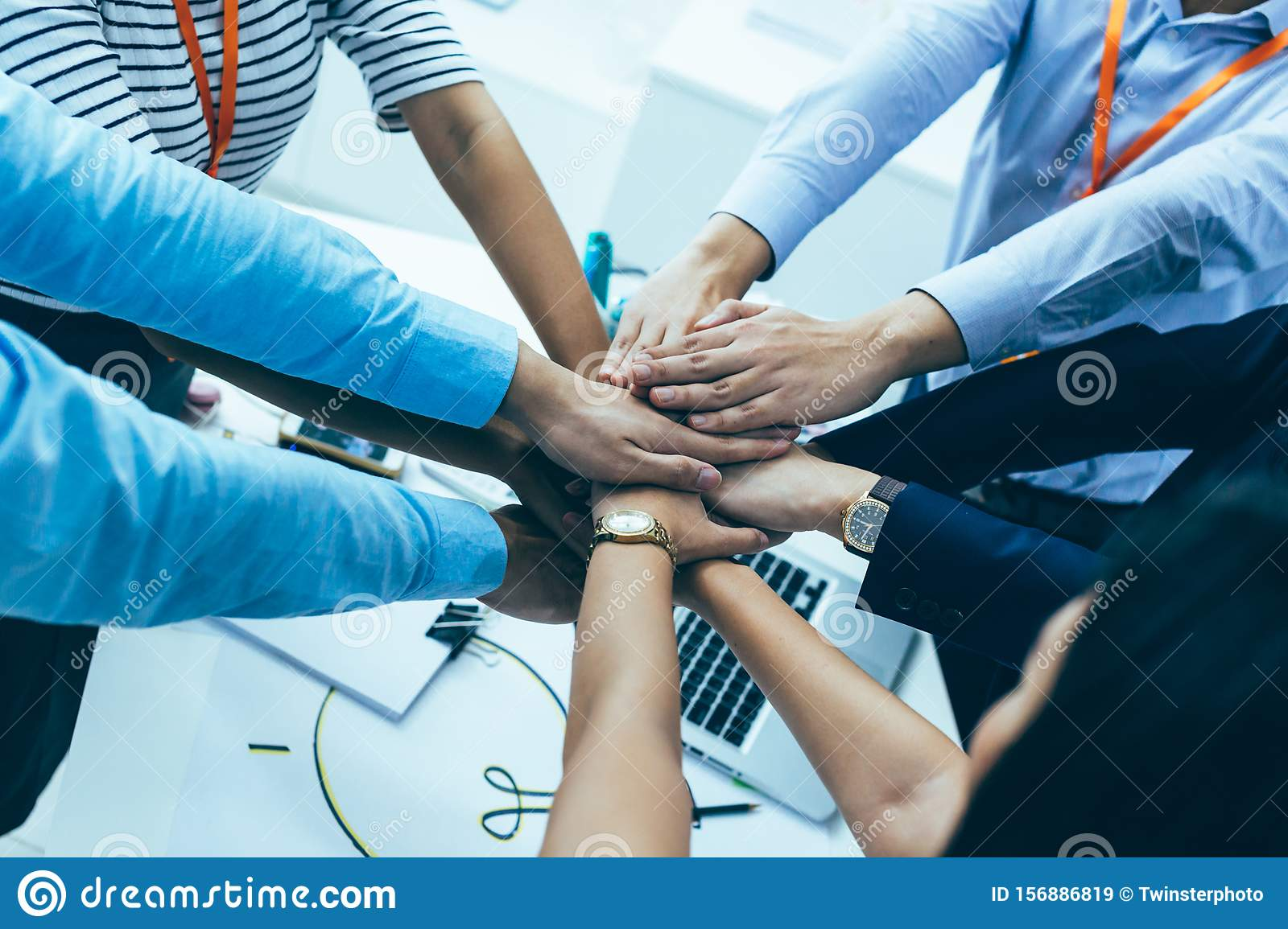 Business People Showing Unity And Collaboration Gesture ...