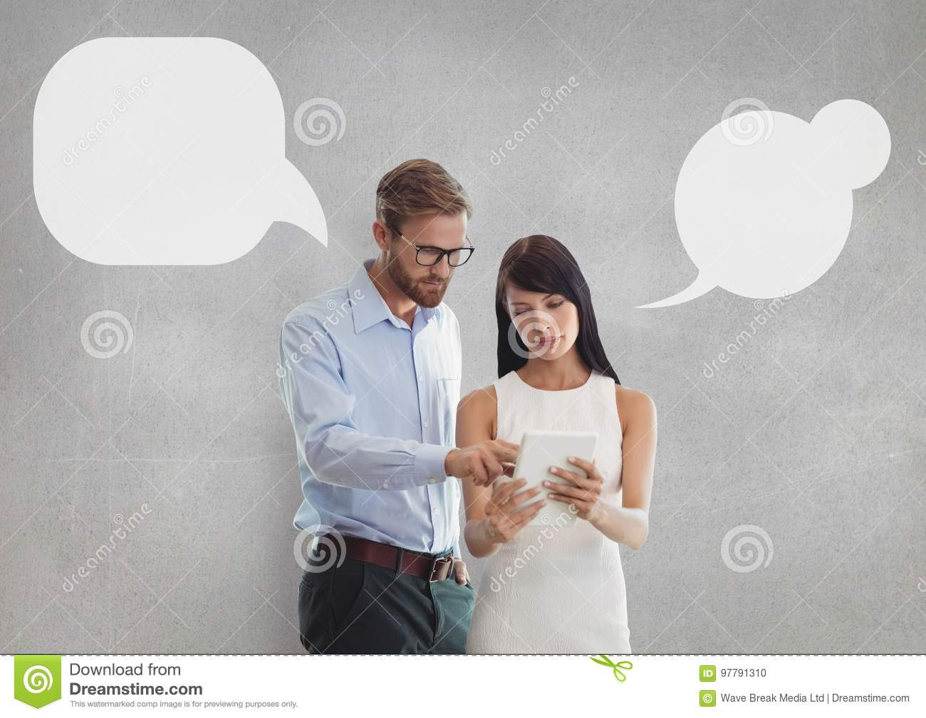 Business people with speech bubbles looking at a tablet against grey background