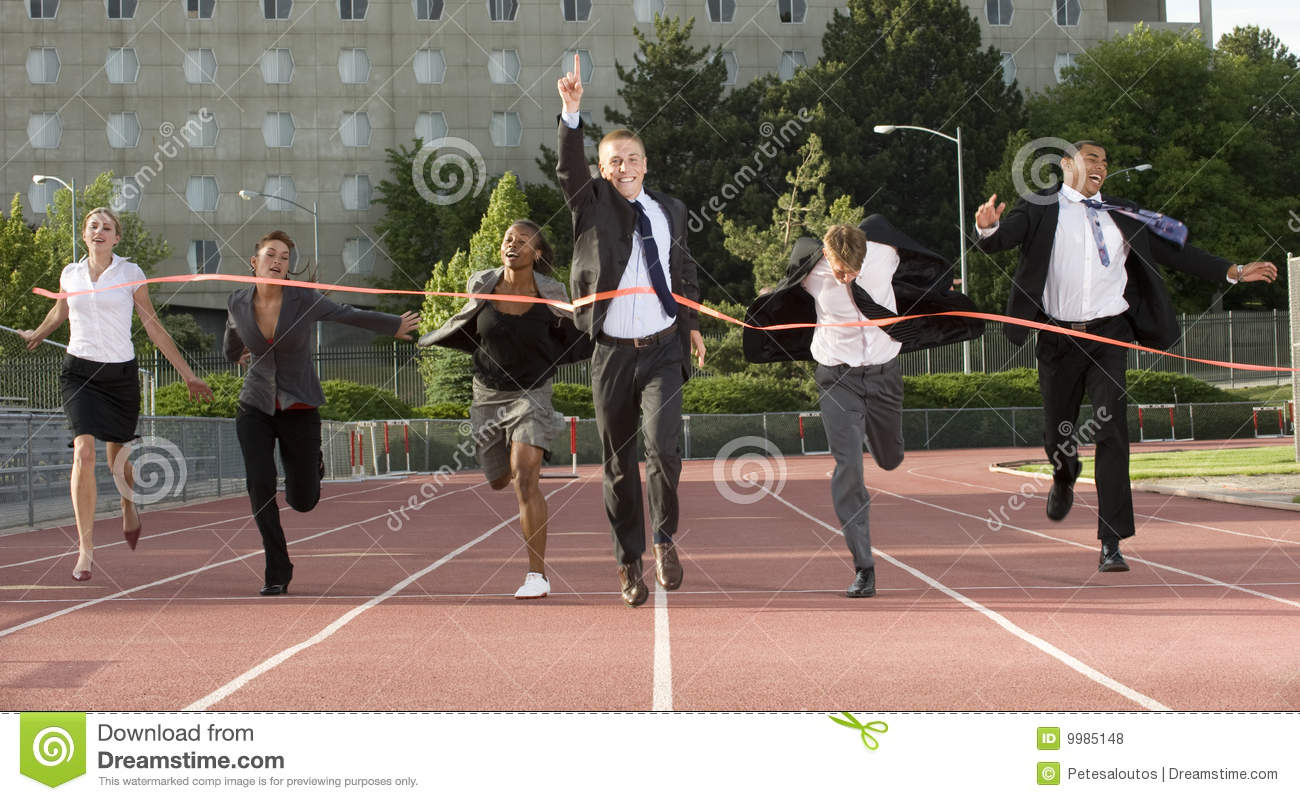Business People Sprinting Across Finish Line Stock Photo ...