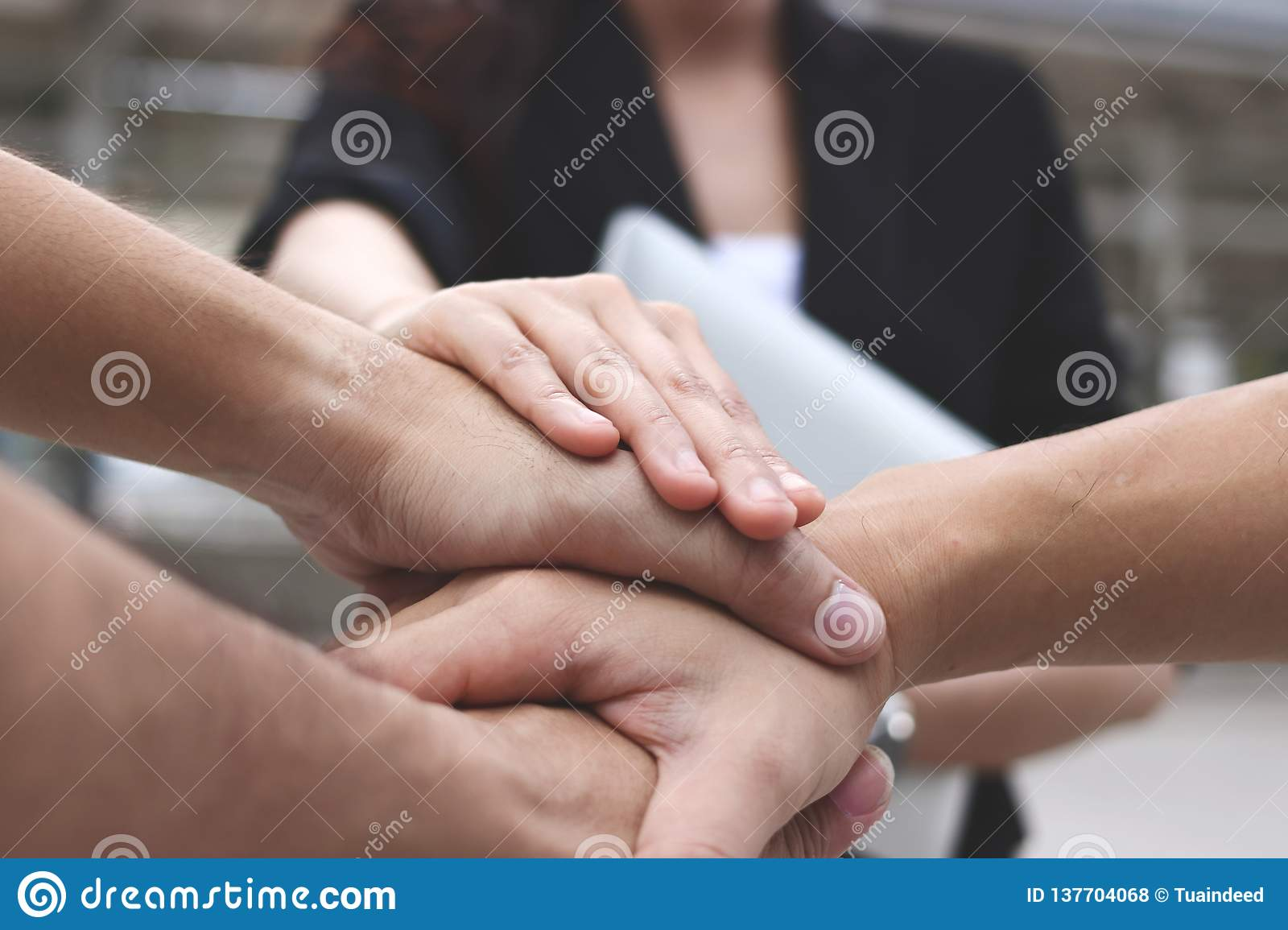 Business people stacking hands together. Successful and teamwork concept