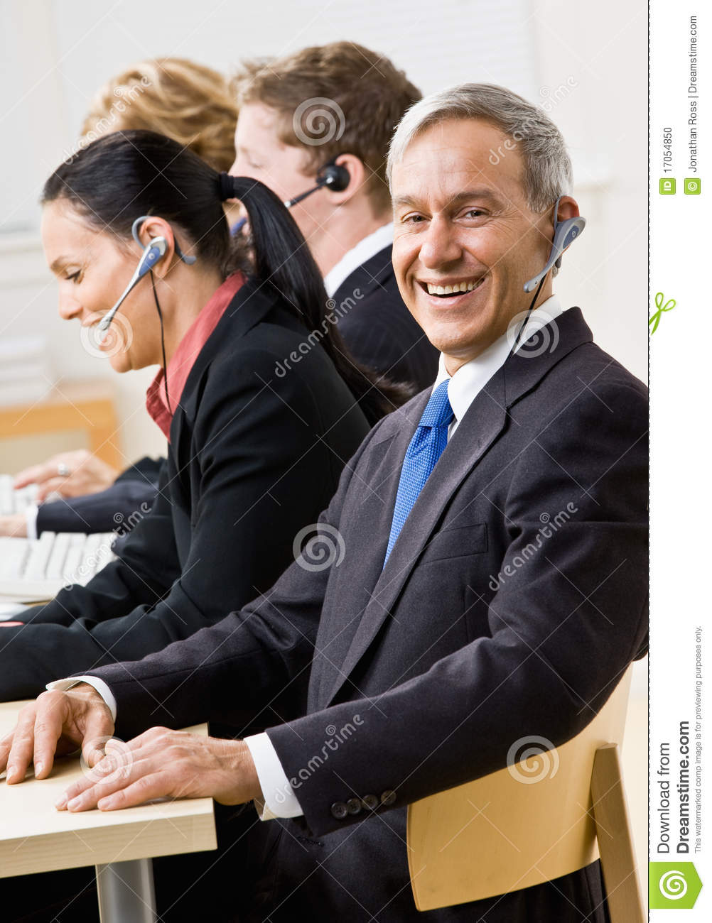 Business People Talking On Headsets Stock Photo Image Of