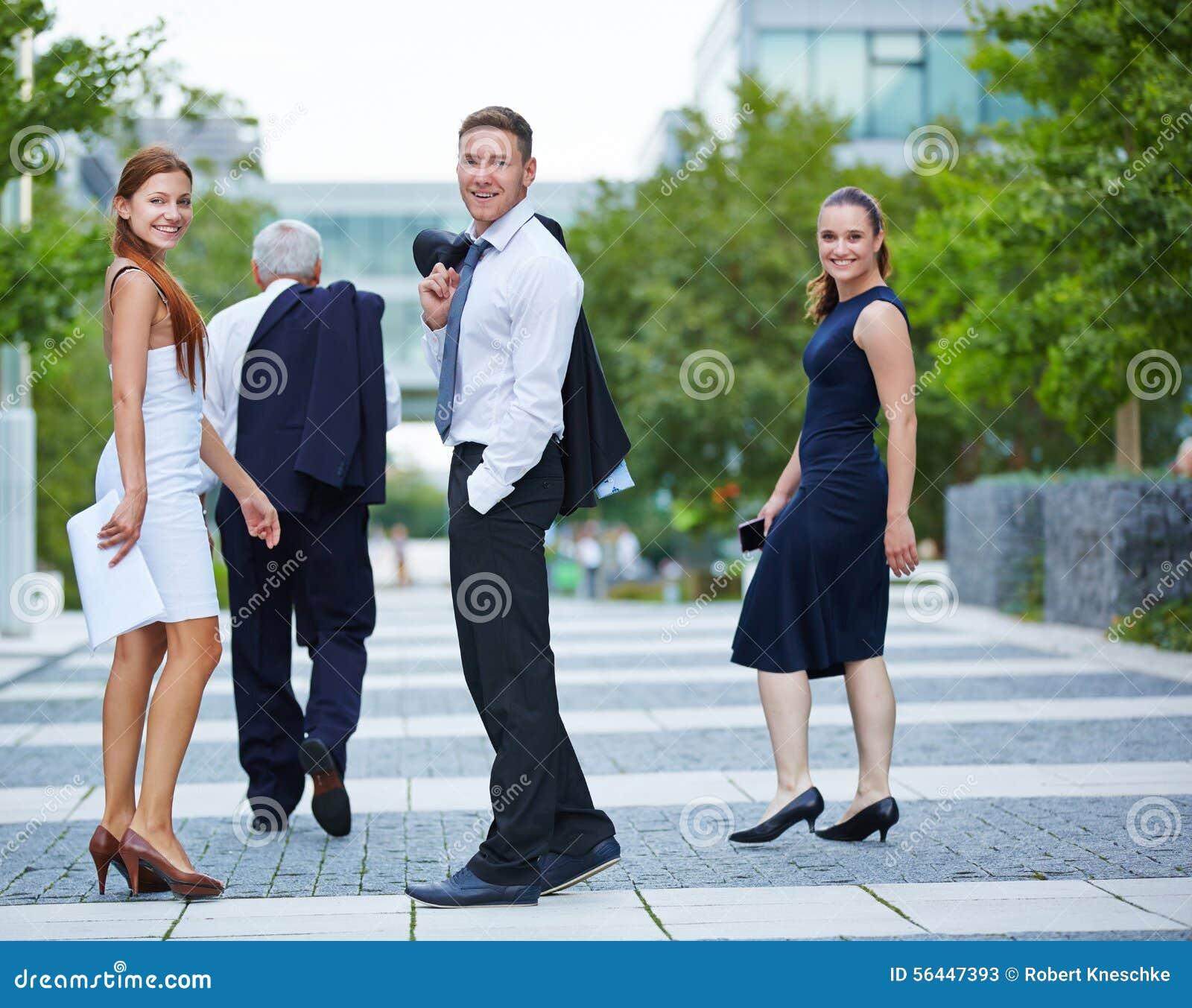 Business People Turning Around While Walking Stock Image