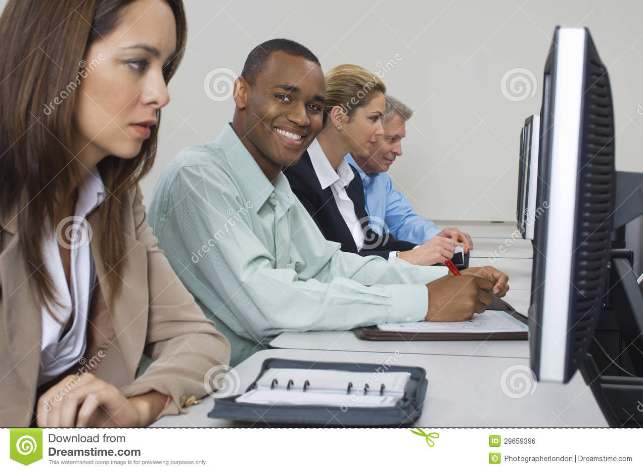 Business People Using Computers In Classroom Royalty Free Stock Image