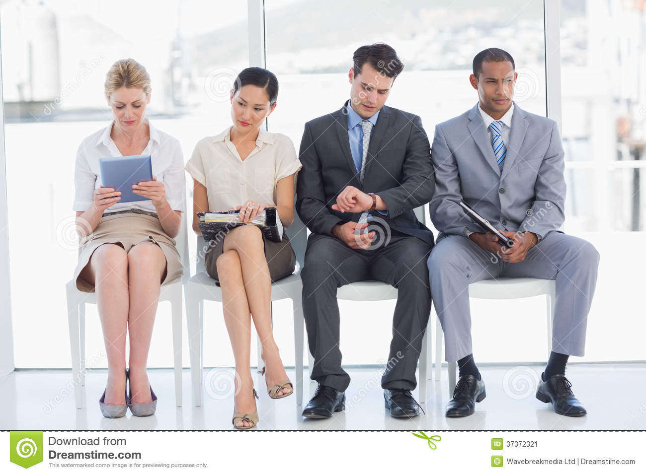 business people waiting for job interview in office stock image business people waiting for job interview in office