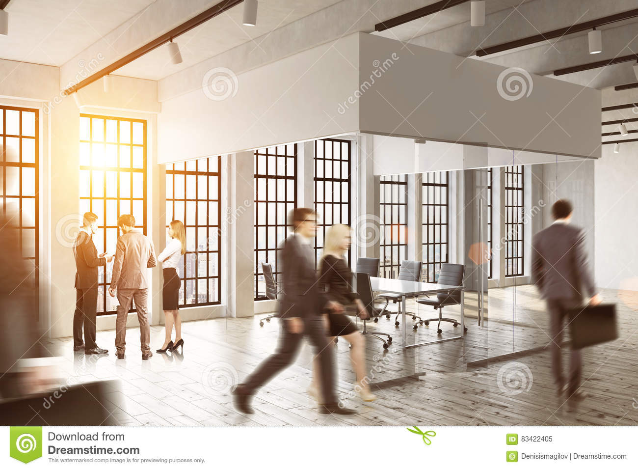 Business people walking in a glass office. Bright sunlight. Concept of office life.