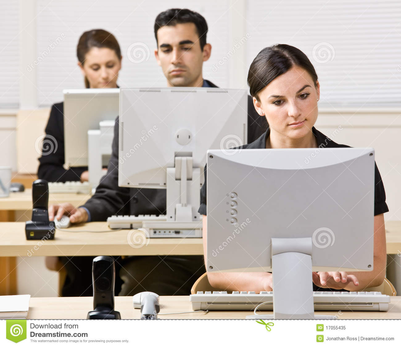 Business People Working On Computers Royalty Free Stock Photo - Image