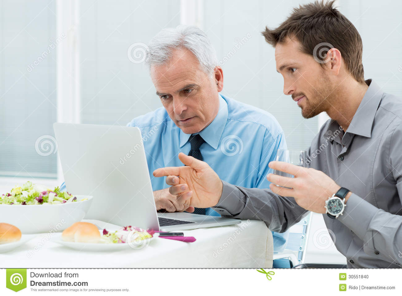 Business People Working At Lunch Stock Photo Image 30551840