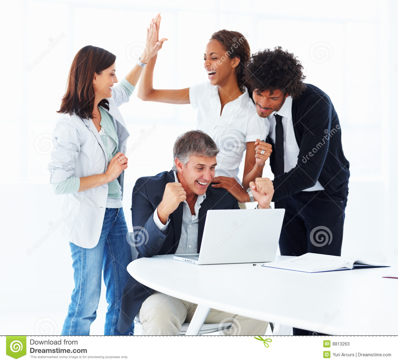 Stock Photos: Business people working together on a laptop. Image
