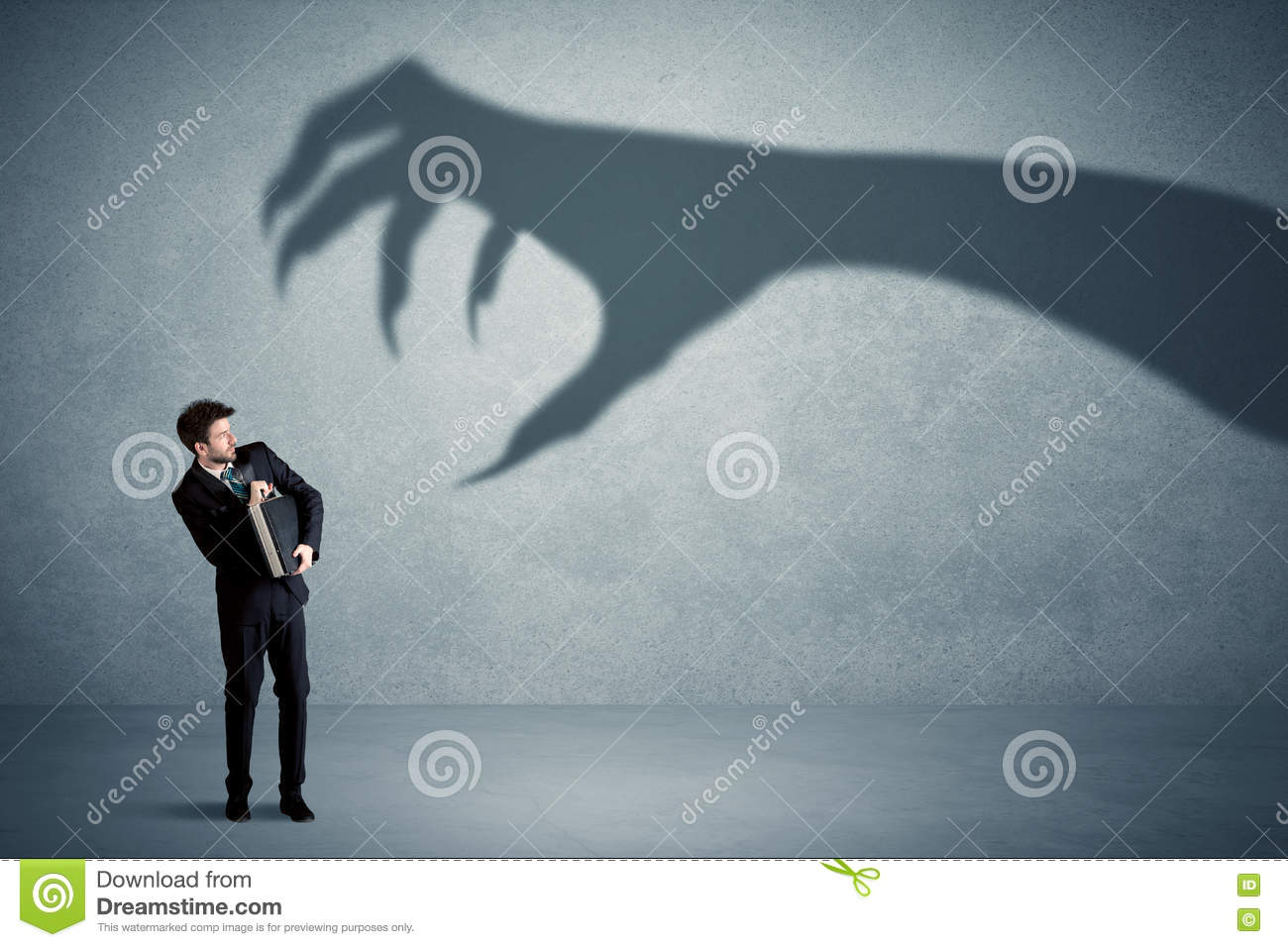 business person afraid of a big monster claw shadow concept stock