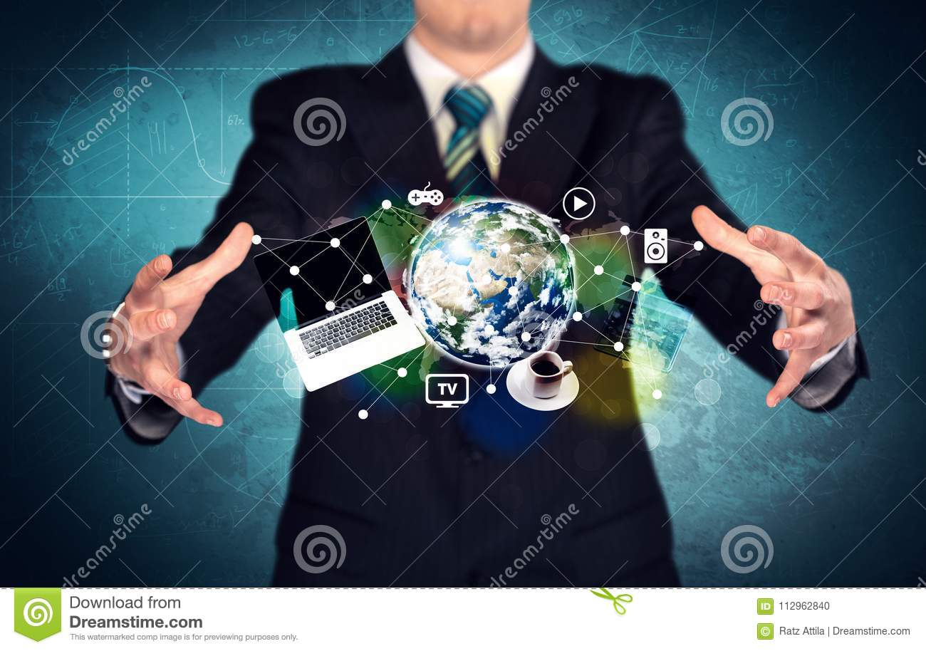 Technology Management Image: Business Person Holding Laptop And Globe Stock Photo