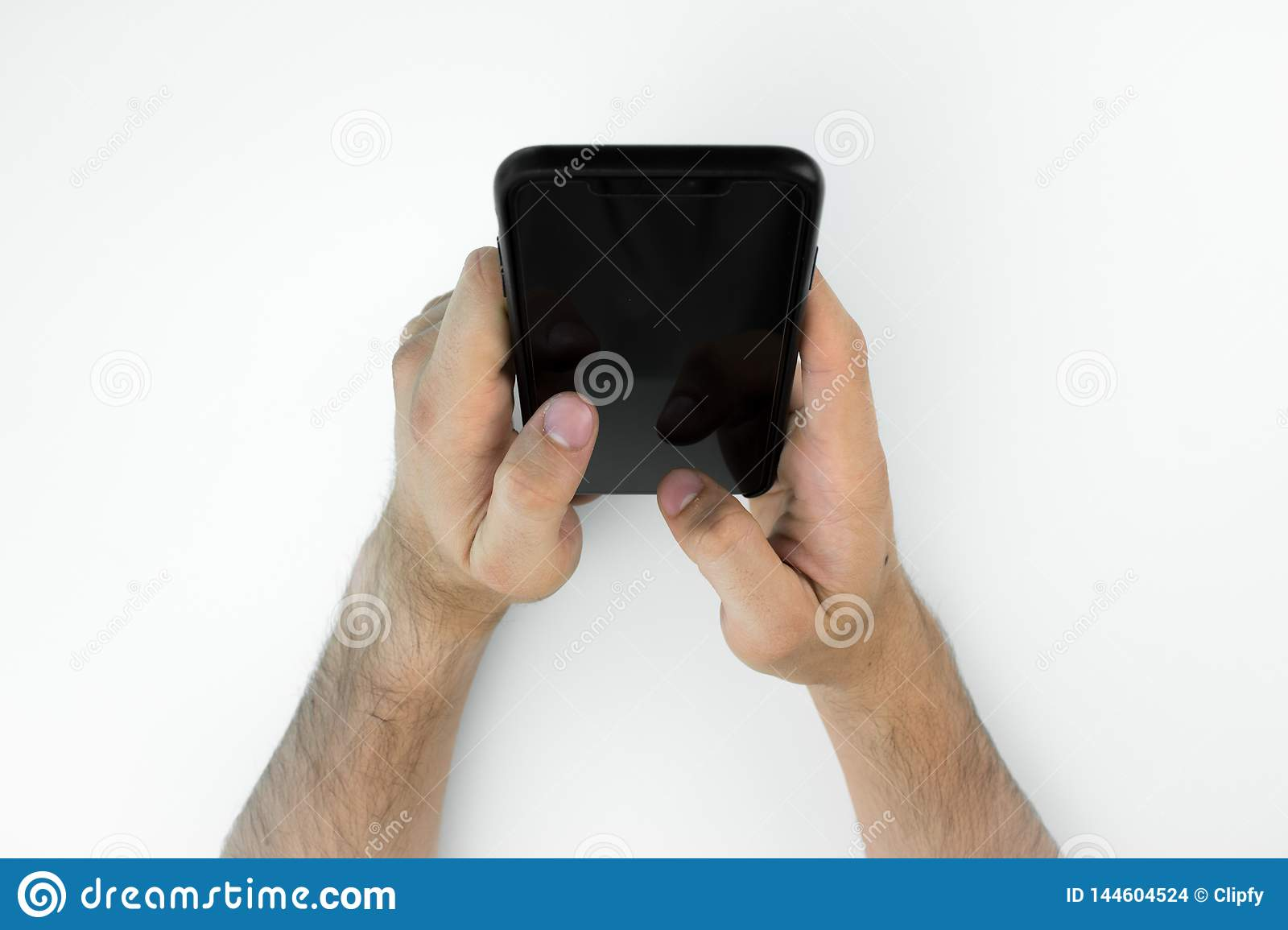 Business person using his smartphone on a white table.