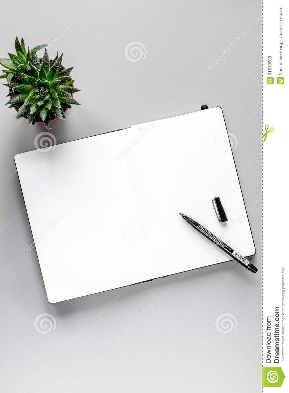 business plan with copybook on gray table background top view mock