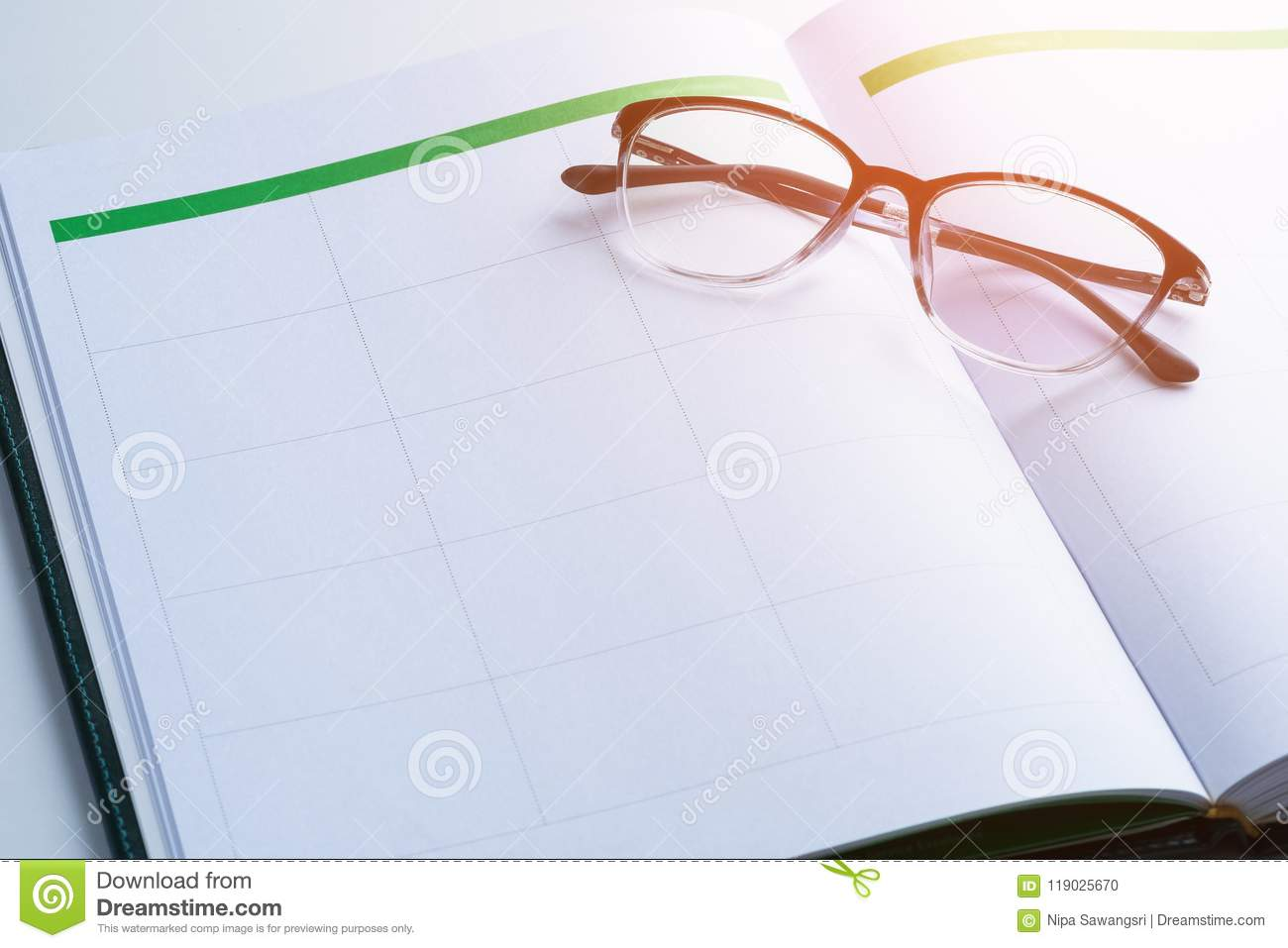 business reminder concept with appointment book glasses stock photo