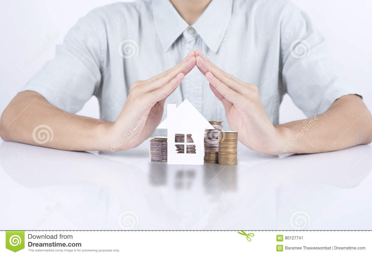 Business salesman hand protection home with money concept home.
