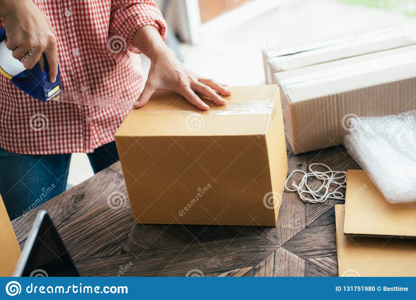 Business Start up SME concept. Young startup entrepreneur small business owner working at home, packaging and delivery situation