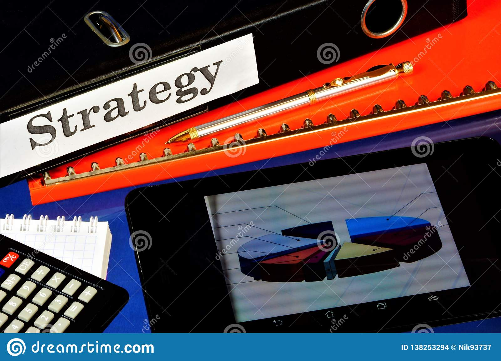 Business strategy, successful, work of the office. On the desktop folder for documents, Notepad for important records, pen,