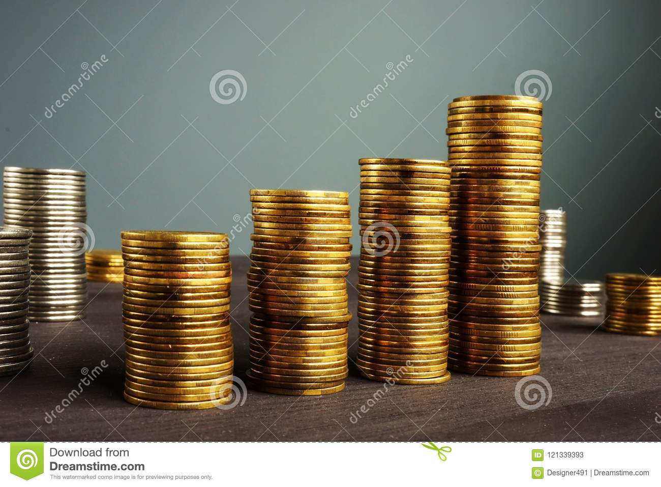 Business success. Coins stackson a desk. Financial growth.
