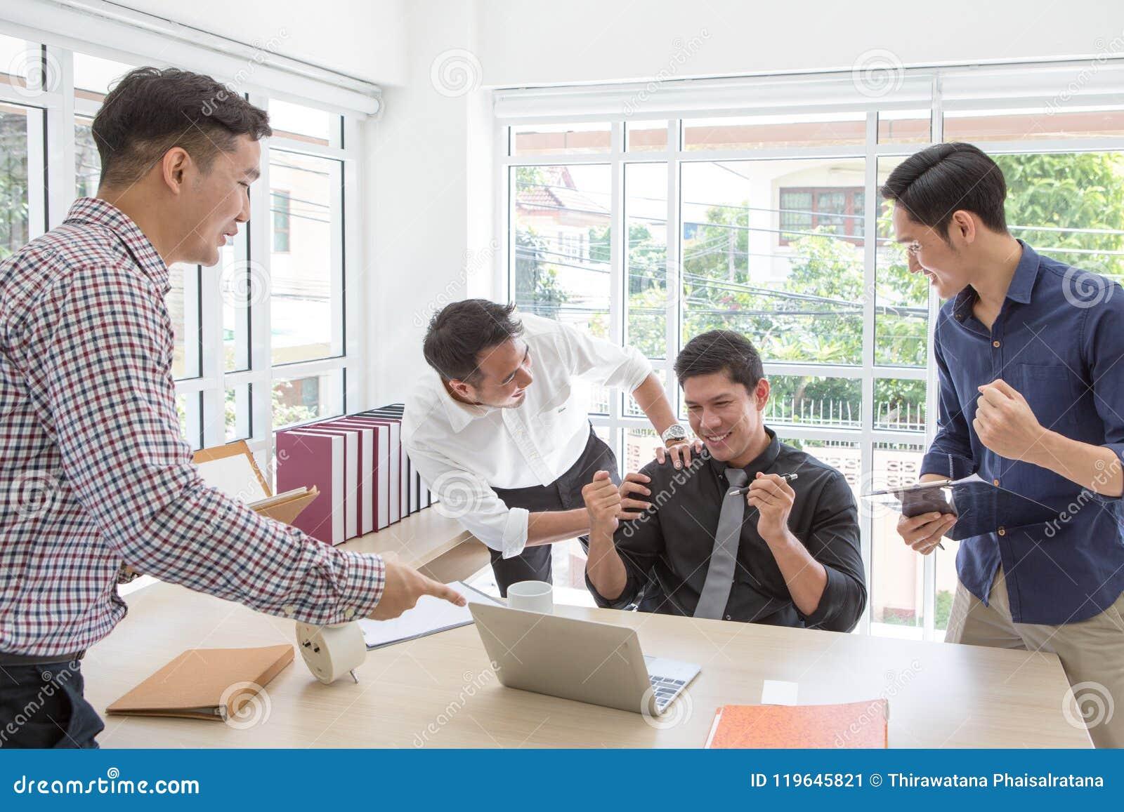 Business successCelebrate success. Business team celebrate a good job in the office.