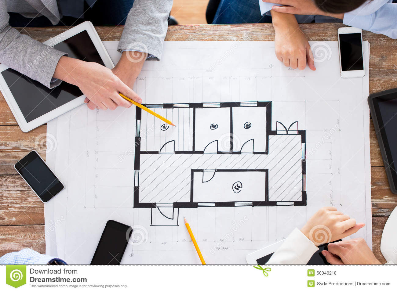 Business team with blueprint and gadgets stock photo image of download business team with blueprint and gadgets stock photo image of application outline malvernweather Gallery