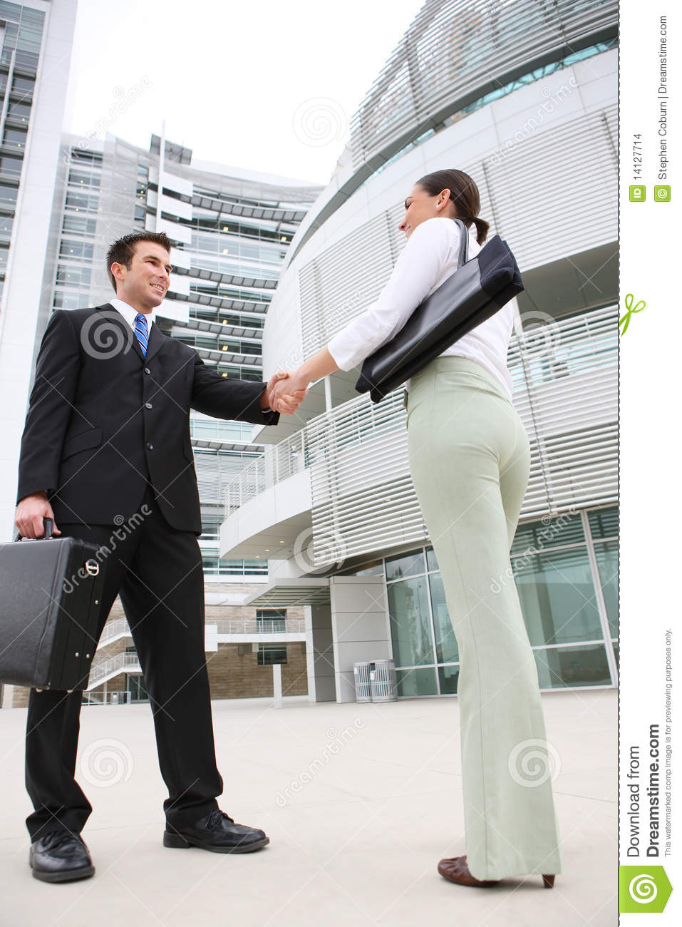 A Business Man Team Handshake At Office Building