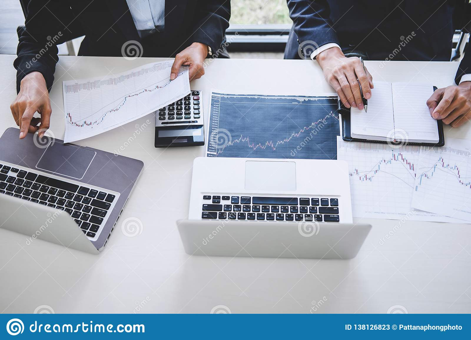 Business Team Investment Working With Computer And Analysis Graph