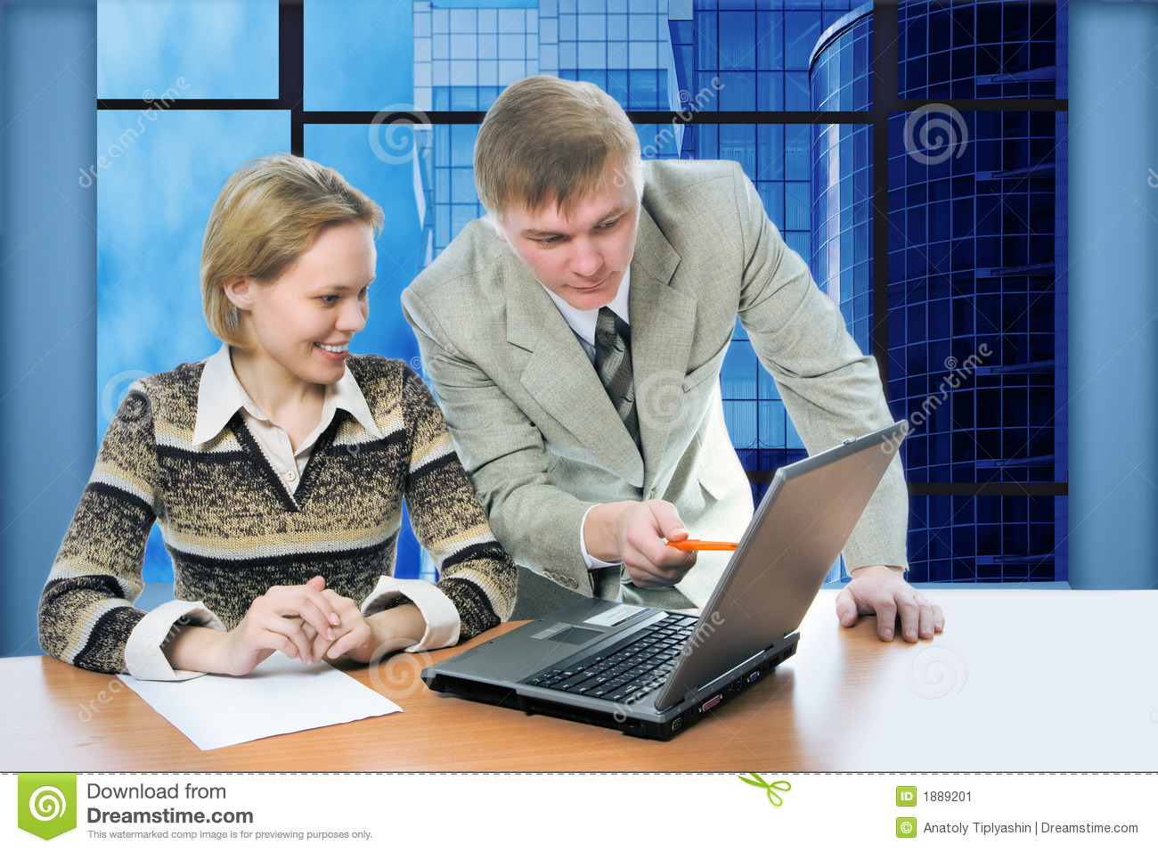 Business team man and woman work in office on laptop with view business buildings