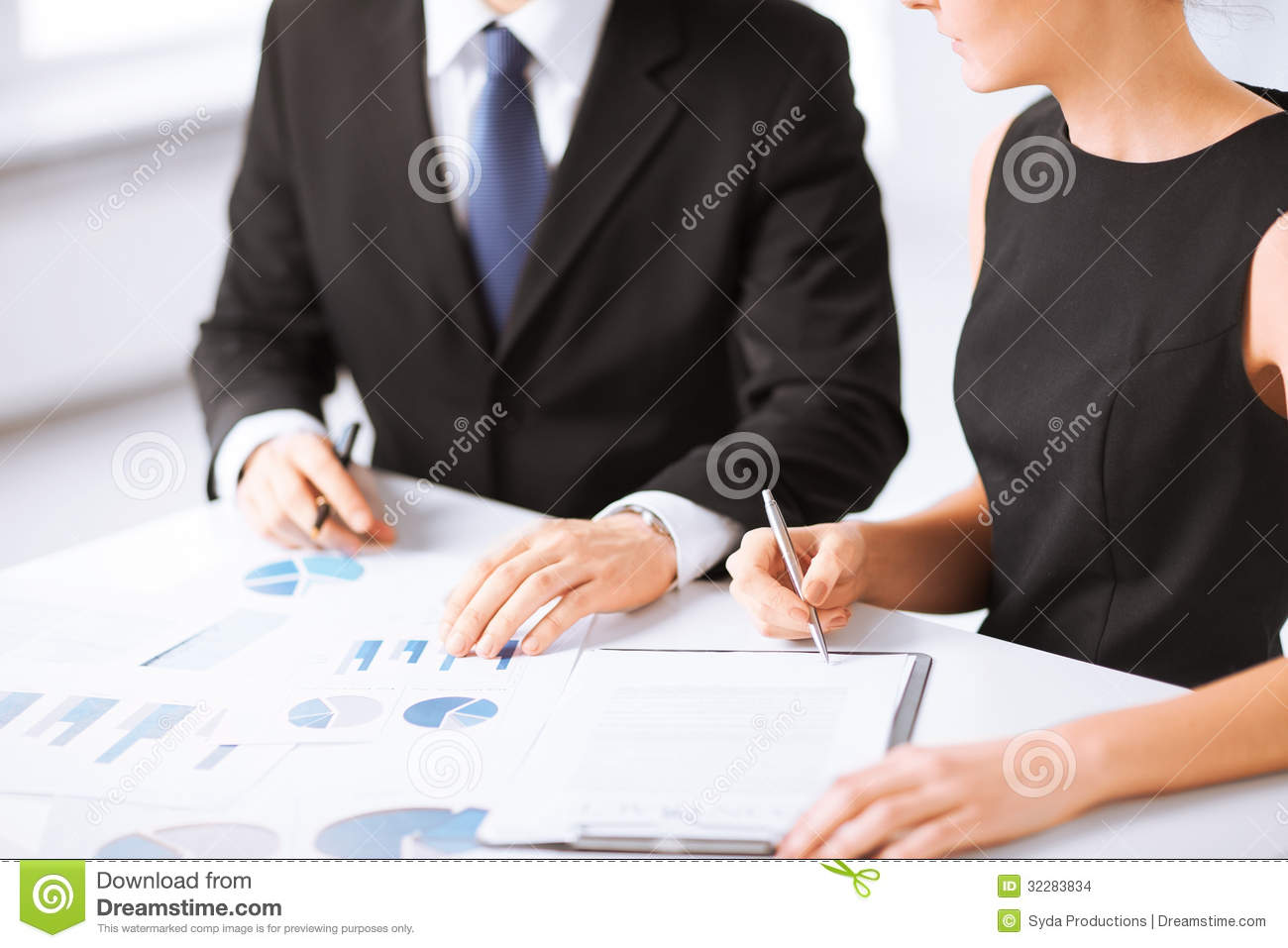 Business team on meeting discussing graphics