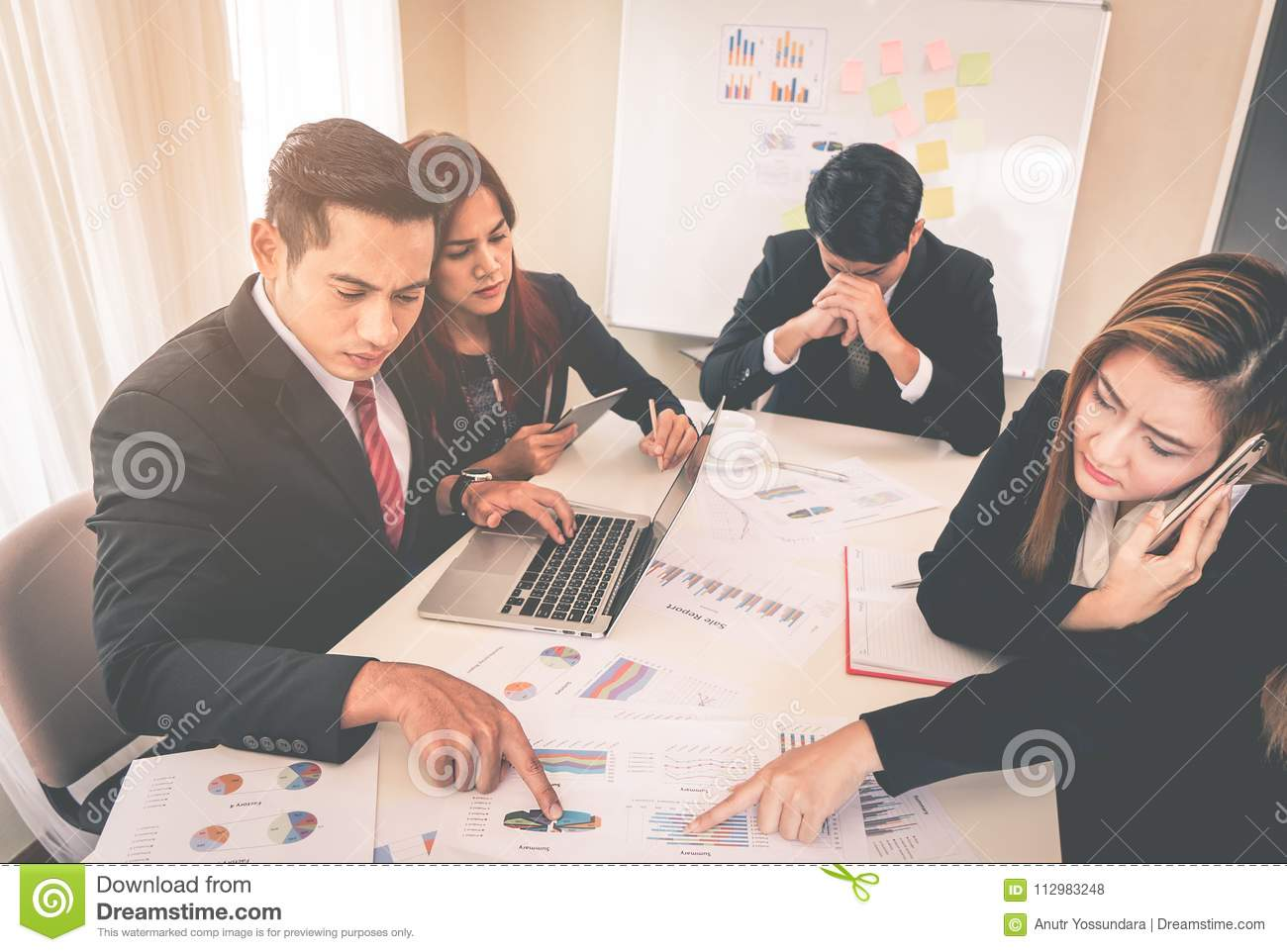 Business team in meeting stressed out with meeting performance