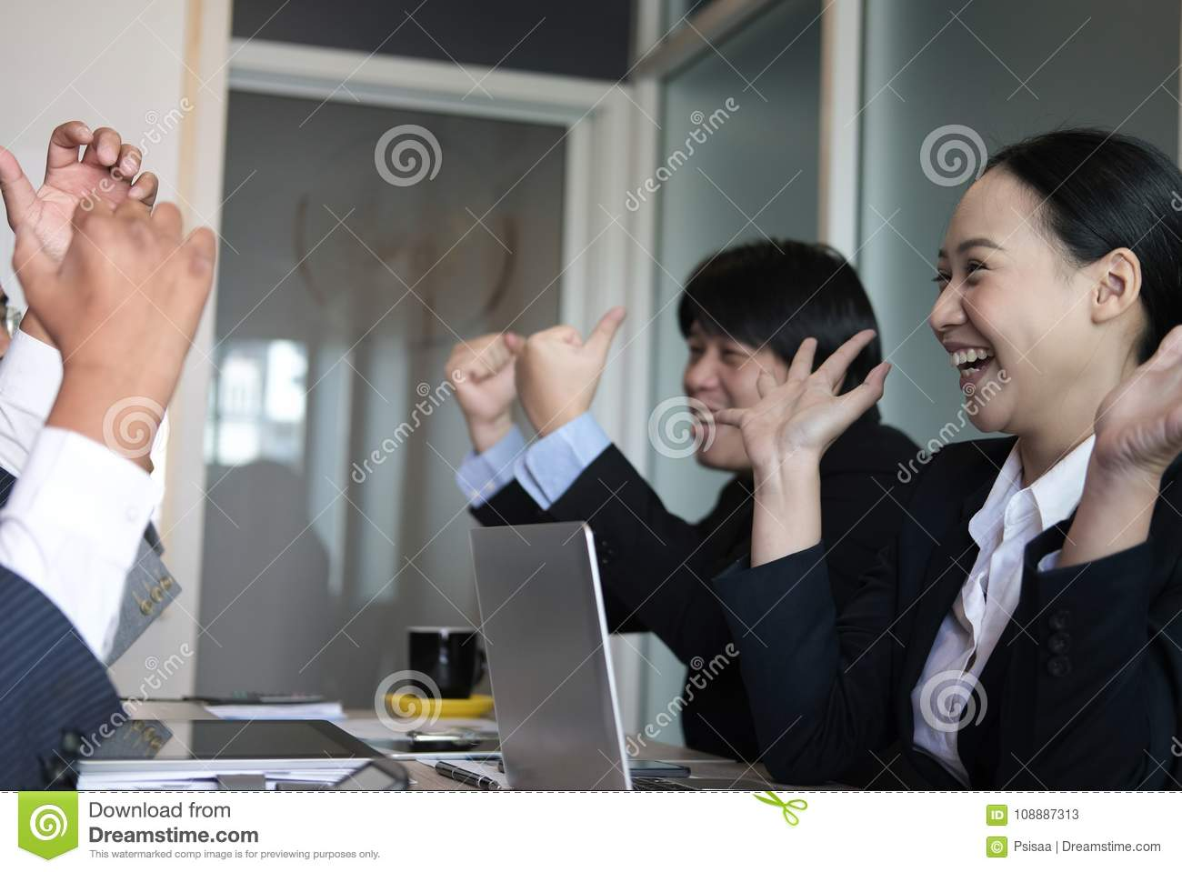 business team raise hands with happiness for successful project. cheerful asian businessman & businesswoman showing gladness